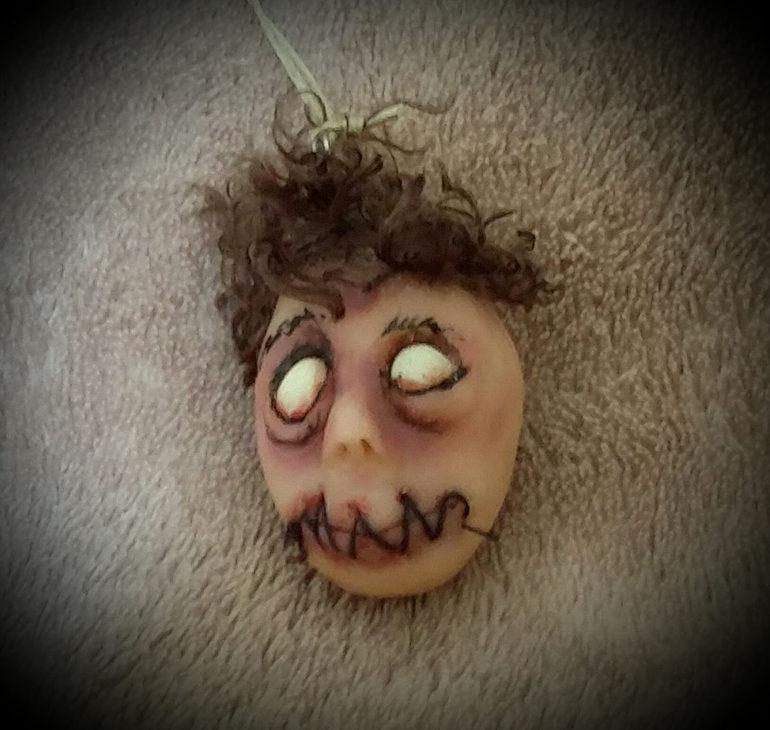 Dead eyed shrunken head by Tina Parsons