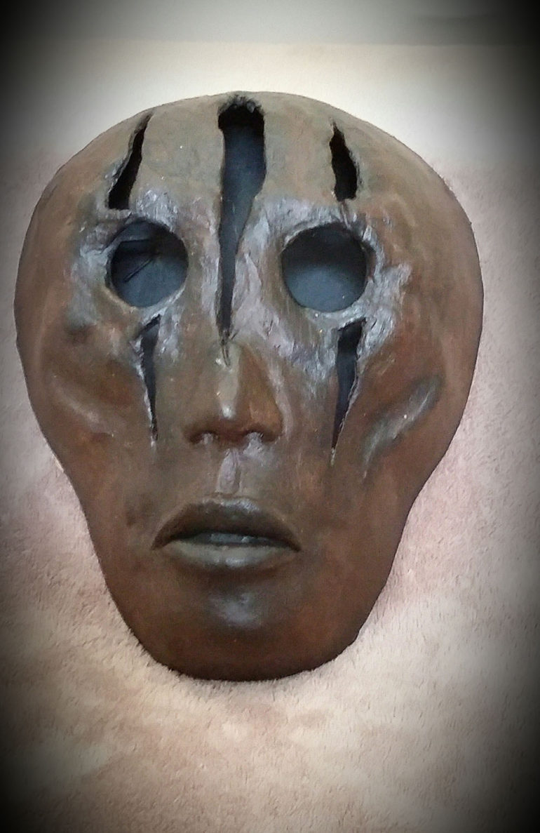 Eye hole clawed mask by Tina Parsons